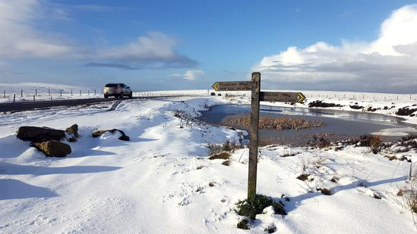 Snow settles along the summit of the Snake Pass, on the A57, in the Peak District, Derbyshire.