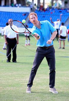 Prince Harry trying out different sports yesterday at a youth sports festival in Sir Vivian Richards Stadium which showcased Antigua and Barbuda's national sports on the second day of his official visit to the Caribbean