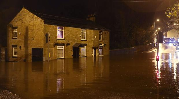 Flooding on Huddersfield Road in Stalybridge, Greater Manchester, as heavy rain has fallen in the region