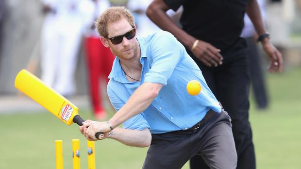 Prince Harry plays cricket on the second day of his tour of the Caribbean