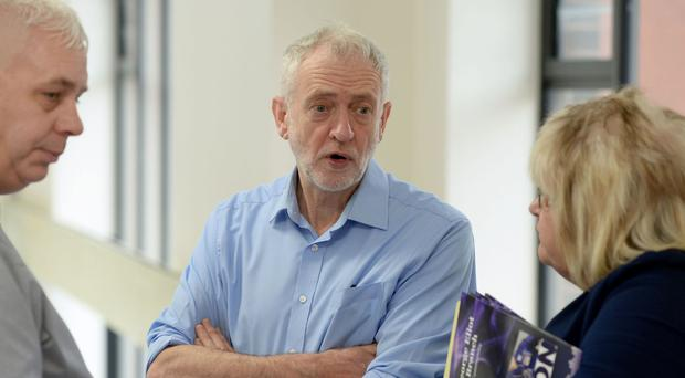 Labour party leader Jeremy Corbyn talks to union staff during a visit to George Eliot Hospital in Nuneaton