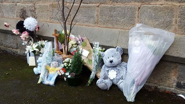 Tributes left at St Peters Church, Bramley, Leeds, where a newborn baby was found and pronounced dead soon after