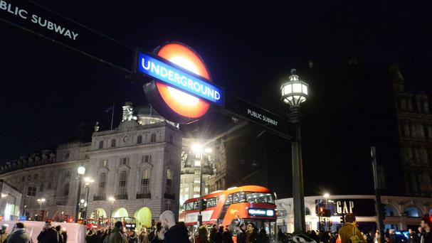 No adverts are on display at Piccadilly Circus, London, as a power cut has plunged parts of central London into darkness