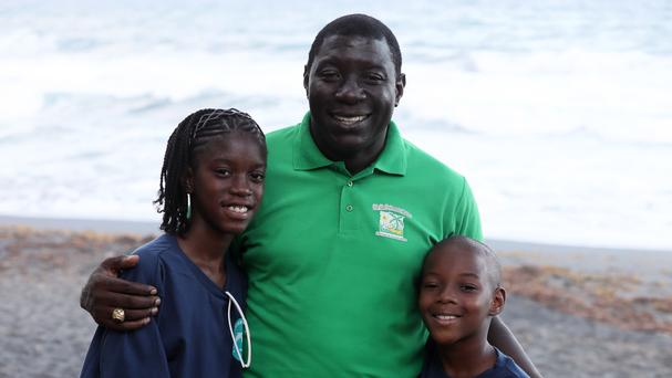 Roseman Adams with his children Ashara and Akaroese who met Prince Harry at a Turtle Conservation Project at Colonarie Beach, Saint Vincent and the Grenadines