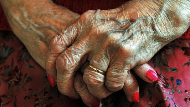 File photo dated 05/12/08 of the hands of an elderly woman. The country is on the brink of a social care crisis unless more money is pumped into the care of the elderly, Theresa May has been warned.
