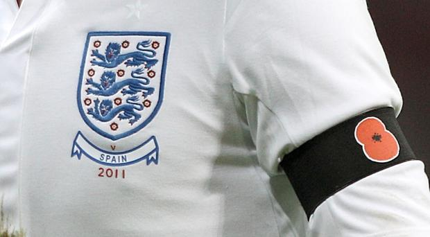 England player wearing a black armband with poppy symbol