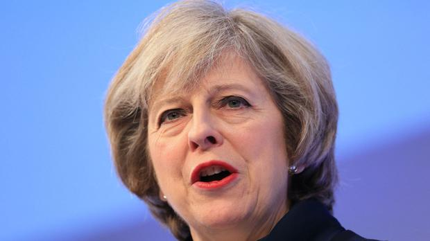 Theresa May's policy of cutting the welfare budget in times of austerity overlooks its role in a nation's economic success, academics have said.