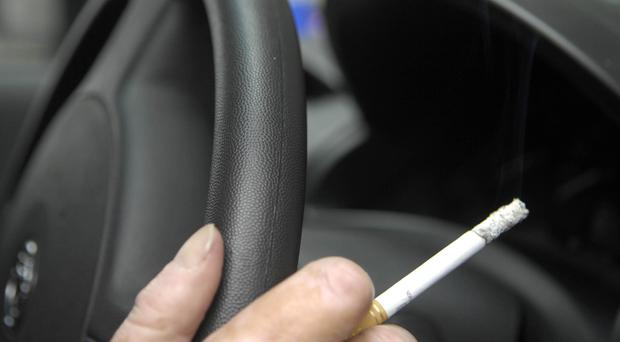 The new law means anyone caught smoking in a private vehicle with someone under 18 present will be fined £100