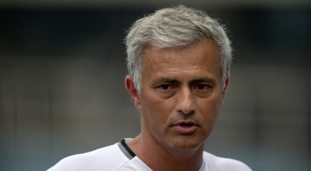 FILE - In this July 24, 2016, file photo, Manchester United manager Jose Mourinho speaks to the media before the team's training session at the Olympic Sports Center Stadium in Beijing. A group of European media outlets on Friday, Dec. 2, 2016, published what it claims are details of tax arrangements made by several top soccer players and coaches, including Real Madrid forward Cristiano Ronaldo, Mourinho and Arsenal midfielder Mesut Ozil. (AP Photo/Mark Schiefelbein, File)