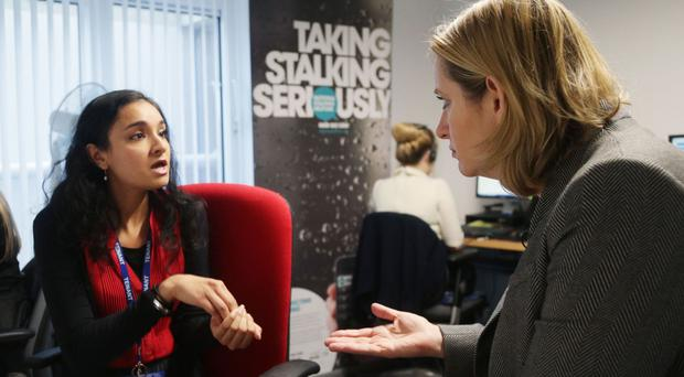 Home Secretary Amber Rudd, right, chats to Suky Bhaker, policy and development director, during a visit to the Suzy Lamplugh Trust ahead of the announcement of the new orders