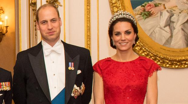 The Duke and Duchess of Cambridge arrive for the annual evening reception for members of the Diplomatic Corps at Buckingham Palace