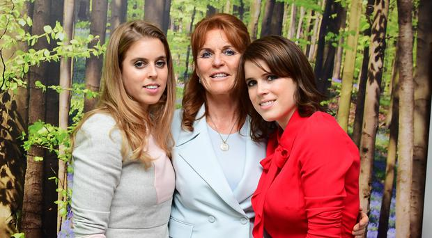 Princess Beatrice, left, the Duchess of York, centre, and Princess Eugenie meet young patients at a Teenage Cancer Trust's young persons unit