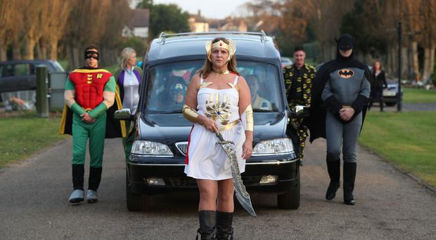 Co-op Funeralcare Funeral Director Cindi Gordon dressed as She-Ra leads the funeral cortege of 18-year-old Arthur Peebles on its way to North East Surrey Crematorium in Morden