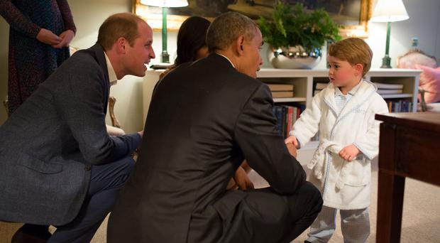 Prince George was in his pyjamas when he met Barack Obama in one of the more uplifting moments of a turbulent 2016