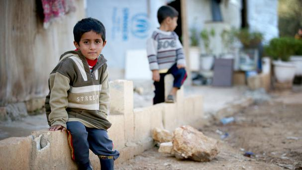 Syrian refugee children in the settlement camp where they live amongst an olive grove in Koura, near Tripoli, Lebanon