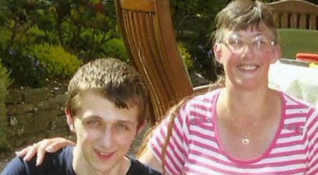 Michael Sandford and his mother Lynne (Family handout/PA)