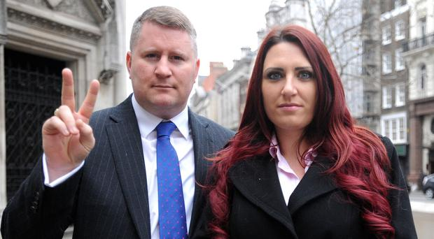 Paul Golding, left, arrives at the Royal Courts of Justice in central London with Britain First's Jayda Fransen