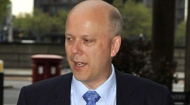 Chris Grayling knocked a cyclist off his bike when opening the door of his ministerial car