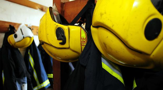 An off-duty firefighter replaced the batteries in a fire alarm that saved a 77-year-old Co Down woman from a blaze just a week before it happened