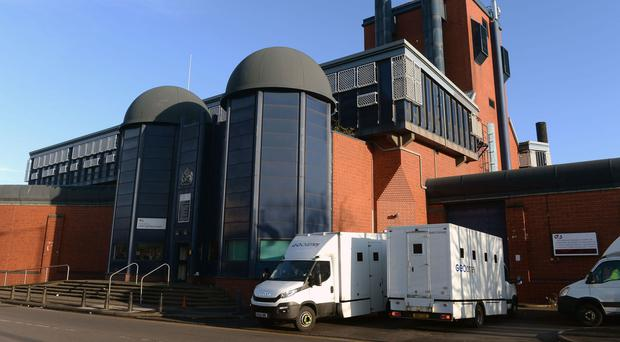 Custody vans leave HMP Birmingham after the disturbance at the jail that prompted politicians to call for a cut in prisoner numbers