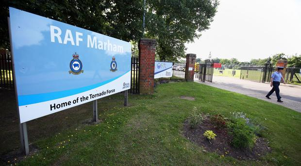 The victim said he was near RAF Marham when he was grabbed by a man who tried to drag him towards a car