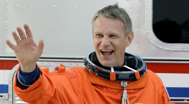 Piers Seller pictured in 2010 before a planned lift-off on the space shuttle Atlantis at the Kennedy Space Centre (AP/Chris O'Meara)