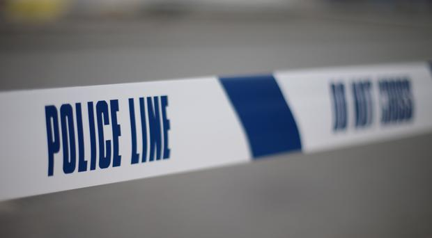 Two men have been found dead in a block of flats at St Austell, Cornwall