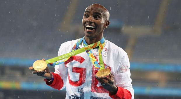 Mo Farah, who is knighted in the New Year Honours, celebrates with his gold medals from the Rio Olympics