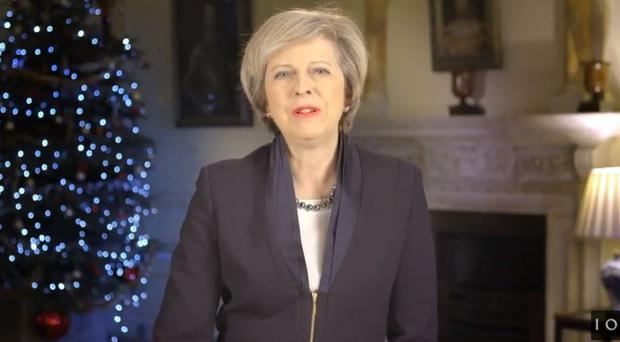 Theresa May called for unity after a 'divisive' Brexit referendum and quoted from murdered Labour MP Jo Cox in her New Year's message