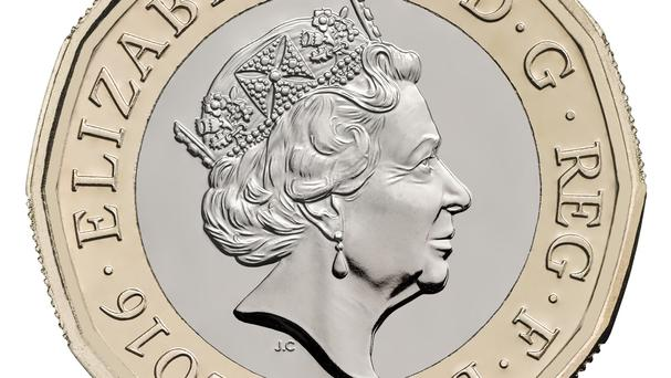 The new 12-sided £1 coin has been called 'the most secure coin in the world' (HM Treasury/PA)