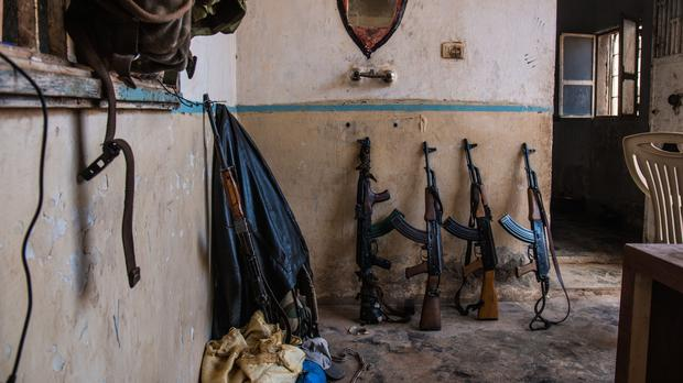 AK47s inside a YPG army base, as the Kurdish military force reported the death of British man Ryan lock