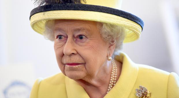 The Queen is said to be up and about and dealing with her red boxes of official papers