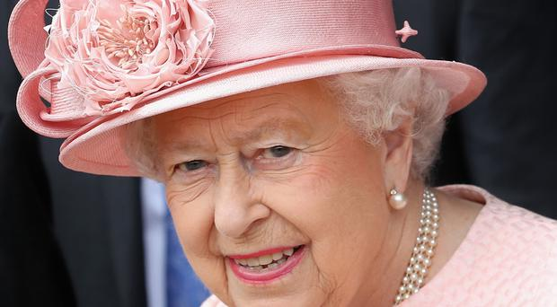 The Queen is said to be up and about and dealing with her red boxes of official papers.