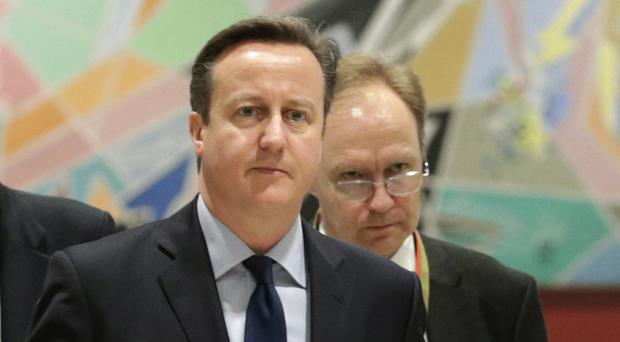 Sir Ivan Rogers, pictured in 2014 with then prime minister David Cameron (AP)