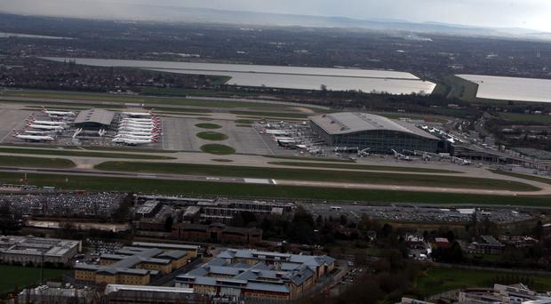The man was arrested after getting off a plane at Heathrow
