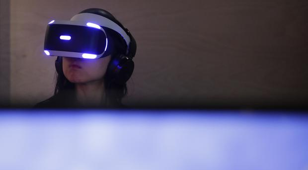 An attendee tries out the Sony PlayStation VR headset at CES (AP Photo/Jae C Hong)