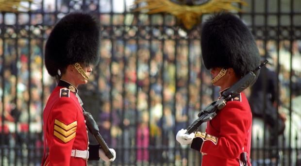 Guardsmen of the Scots (left) and Coldstream Guards taking part in the Changing the Guard ceremony at Buckingham Palace in London