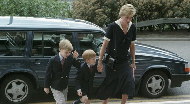 Diana, Princess of Wales, accompanied by Prince William and Prince Harry, pictured at the Queen's Medical Centre in Nottingham
