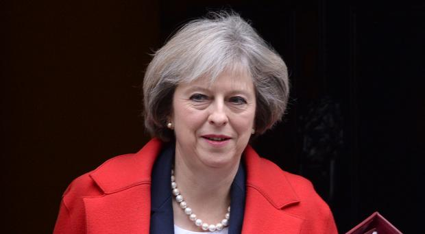 Prime Minister Theresa May has vowed to help Turkey defeat terrorism