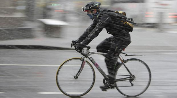 Lawyers say bicycle couriers carry out physically demanding work, in dangerous conditions, but cannot take paid leave