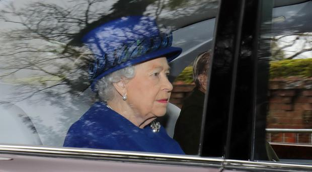 The Queen arriving to attend the morning church service at St Mary Magdalene Church in Sandringham, Norfolk