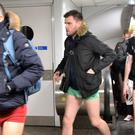 Passengers take part in the No Pants Tube Ride on the London Underground
