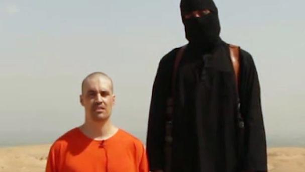 Image taken from footage issued by Islamic State militants that allegedly shows the moments before the killing of US journalist James Foley.