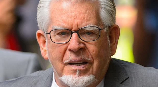 Rolf Harris is accused of indecently assaulting girls