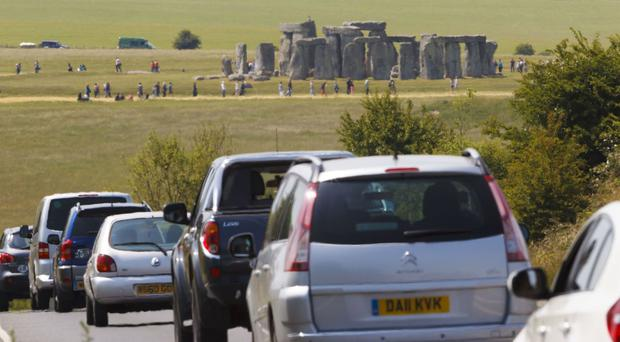 Traffic queues along the A303 past Stonehenge in Wiltshire, which is to be moved into a tunnel