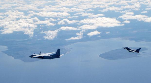A Russian An26 Curl aircraft being intercepted in the Baltics by a Royal Air Force Typhoon fighter jet