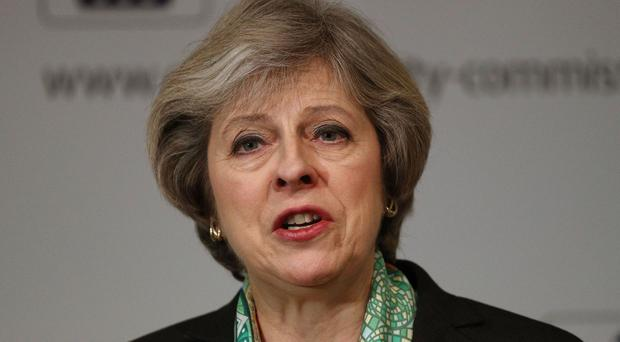 Prime Minister Theresa May has made clear her determination to press ahead with plans for GP surgeries in England to open longer