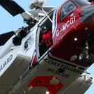 A Coastguard helicopter helped rescue the crew members
