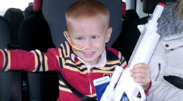 Alex Barnes, pictured during his treatment at the age of five, has been given the all-clear after proton beam surgery in the USA, his mother says
