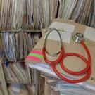 A scheme aimed at making it easier to see a GP and cutting the workload of overstretched doctors has come under fire. File image